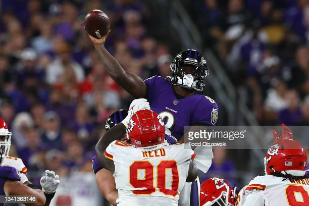 Lamar Jackson of the Baltimore Ravens throws a touchdown pass to Marquise Brown during the third quarter against the Kansas City Chiefs at M&T Bank...