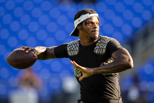 Lamar Jackson of the Baltimore Ravens throws before the preseason game against the New Orleans Saints at M&T Bank Stadium on August 14, 2021 in...