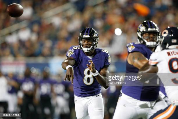 Lamar Jackson of the Baltimore Ravens throws for a touchdown in the third quarter of the Hall of Fame Game against the Chicago Bears at Tom Benson...