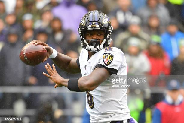 Lamar Jackson of the Baltimore Ravens throws the ball during the first half of the game against the Seattle Seahawks at CenturyLink Field on October...