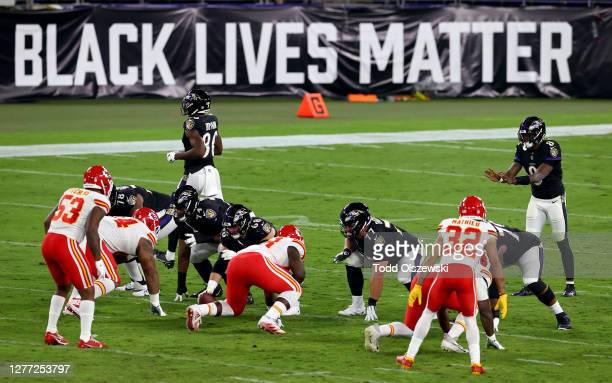 """Lamar Jackson of the Baltimore Ravens waits for the snap in front a sign that reads """"Black Lives Matter"""" against the Kansas City Chiefs at M&T Bank..."""
