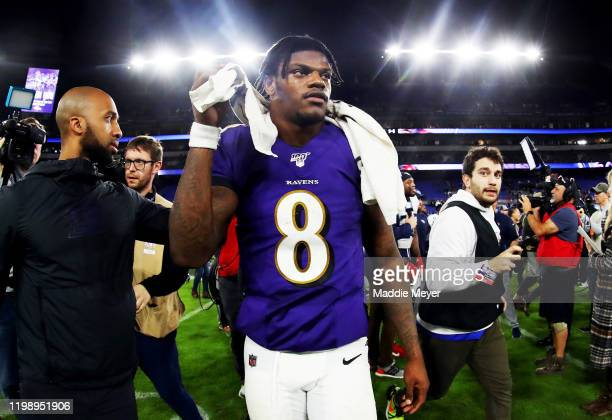 Lamar Jackson of the Baltimore Ravens walks off the field after being defeated by the Tennessee Titans in the AFC Divisional Playoff game 2812 at MT...
