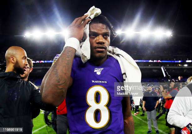 Lamar Jackson of the Baltimore Ravens walks off the field after being defeated by the Tennessee Titans in the AFC Divisional Playoff game 28-12 at...