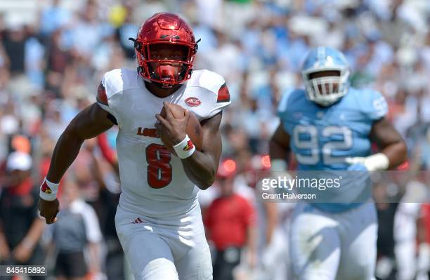 Lamar Jackson of the Louisville Cardinals breaks away from the North Carolina Tar Heels defense for a touchdown during the game at Kenan Stadium on...