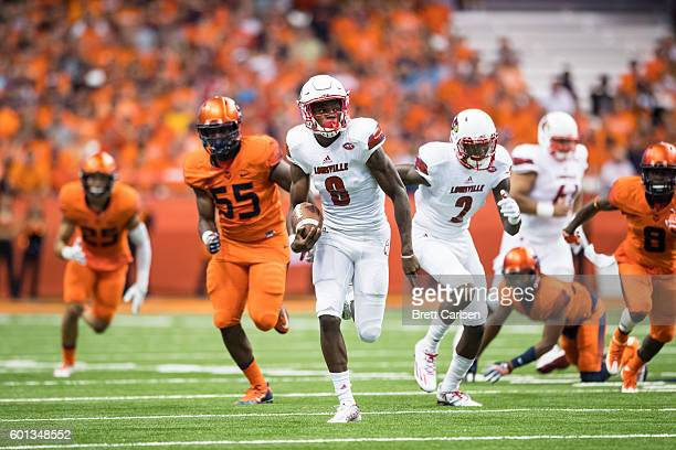 Lamar Jackson of the Louisville Cardinals carries the ball for a touchdown during the first half against the Syracuse Orange on September 9 2016 at...