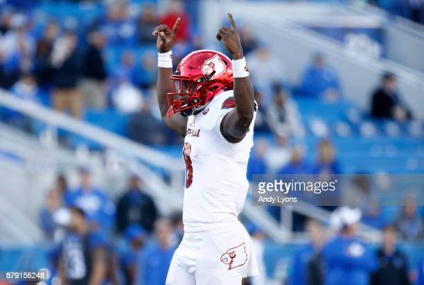 Lamar Jackson of the Louisville Cardinals celebrates a touchdown against the Kentucky Wildcats during the game at Commonwealth Stadium on November 25...