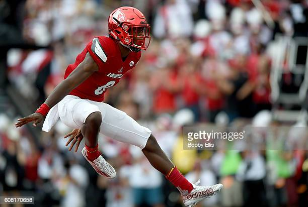 Lamar Jackson of the Louisville Cardinals celebrates after a Louisville touchdown during the game against the Florida State Seminoles at Papa John's...