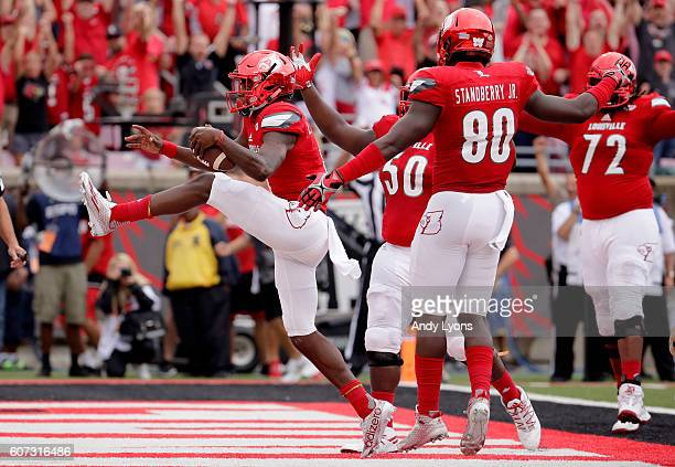 Lamar Jackson of the Louisville Cardinals celebrates as he runs for a touchdown against the Florida State Seminoles at Papa John's Cardinal Stadium...
