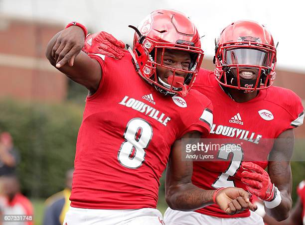 Lamar Jackson of the Louisville Cardinals celebrates with Jamari Staples after he ran for a touchdown against the Florida State Seminoles at Papa...
