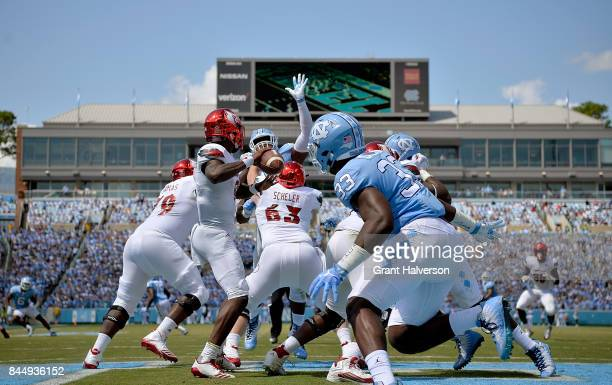Lamar Jackson of the Louisville Cardinals drops back to pass against the North Carolina Tar Heels during the game at Kenan Stadium on September 9...