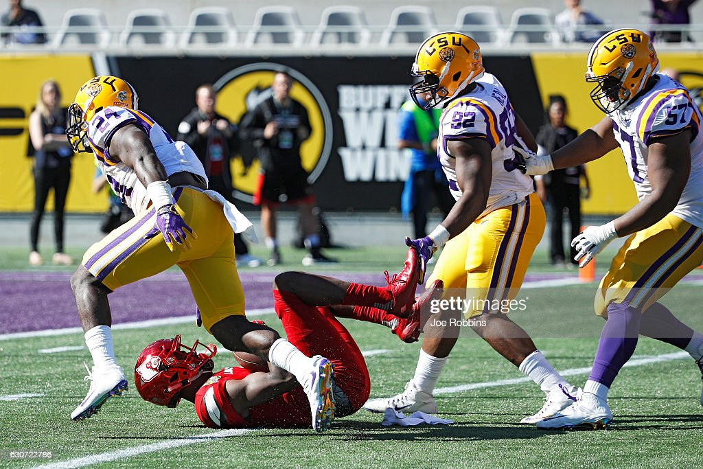 Lamar Jackson #8 of the Louisville Cardinals gets sacked in the first quarter of the Buffalo Wild Wings Citrus Bowl against the LSU Tigers at Camping World Stadium on December 31, 2016 in Orlando, Florida.