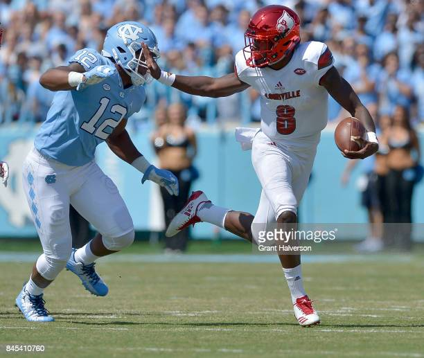 Lamar Jackson of the Louisville Cardinals in action against the North Carolina Tar Heels during the game at Kenan Stadium on September 9 2017 in...