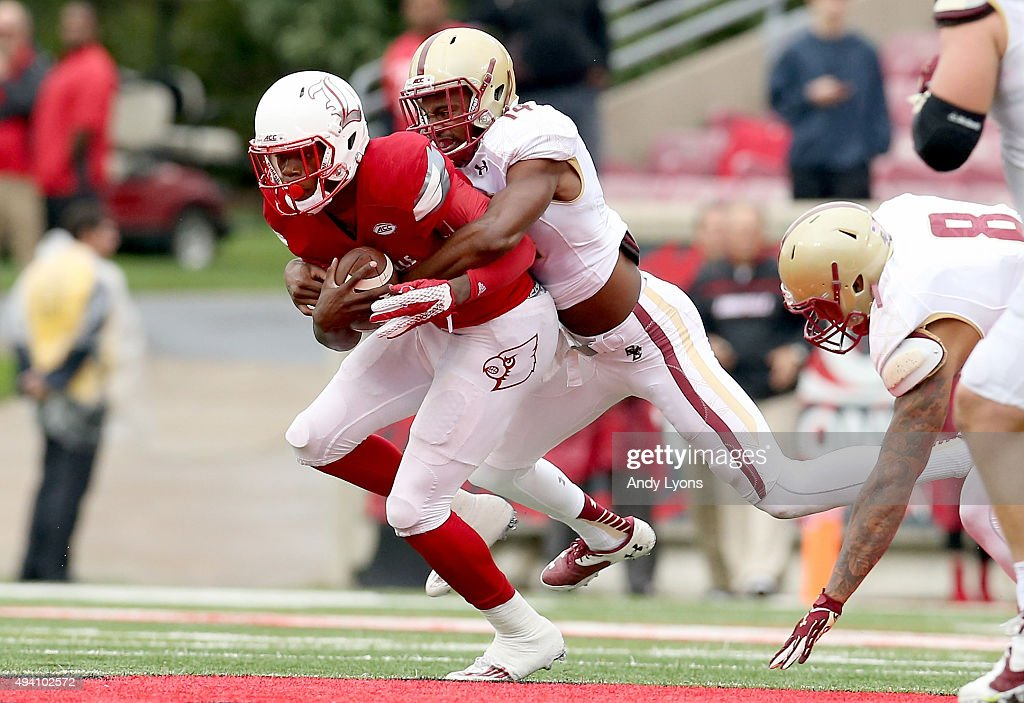 Lamar Jackson #8 of the Louisville Cardinals is sacked by Gabriel McClary #14 of the Boston College Eagles at Papa John's Cardinal Stadium on October 24, 2015 in Louisville, Kentucky.