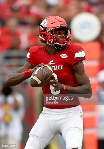 Lamar Jackson of the Louisville Cardinals looks for a receiver during the game against the Florida State Seminoles at Papa John's Cardinal Stadium on...