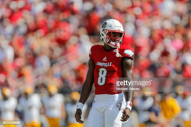 Lamar Jackson of the Louisville Cardinals looks on against the Kent State Golden Flashes during the first half at Papa John's Cardinal Stadium on...