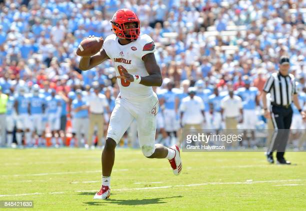 Lamar Jackson of the Louisville Cardinals looks to pass against the North Carolina Tar Heels during the game at Kenan Stadium on September 9 2017 in...