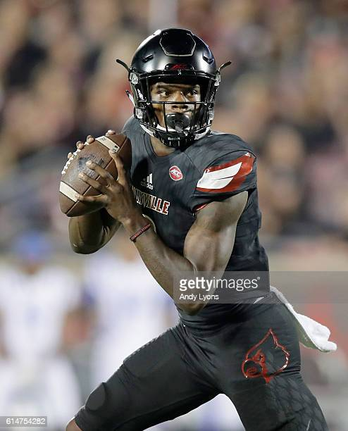 Lamar Jackson of the Louisville Cardinals looks to pass during the game against the Duke Blue Devils at Papa John's Cardinal Stadium on October 14...