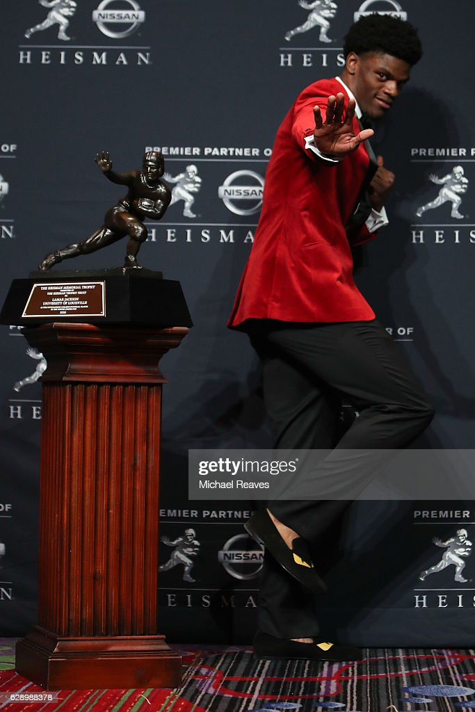 Lamar Jackson of the Louisville Cardinals poses for a photo after being named the 82nd Heisman Memorial Trophy Award winner during the 2016 Heisman Trophy Presentation at the Marriott Marquis on December 10, 2016 in New York City.