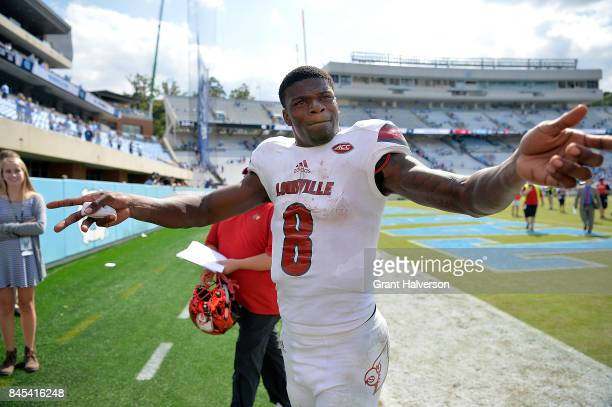 Lamar Jackson of the Louisville Cardinals reacts to the fans as he leaves the field after a win against the North Carolina Tar Heels during the game...