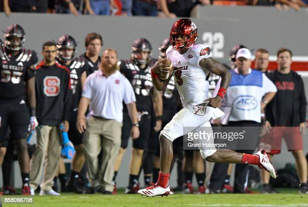 Lamar Jackson of the Louisville Cardinals runs against the North Carolina State Wolfpack during the game at Carter Finley Stadium on October 5 2017...