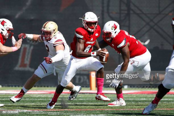Lamar Jackson of the Louisville Cardinals runs away from pressure in the first quarter of a game against the Boston College Eagles at Papa John's...