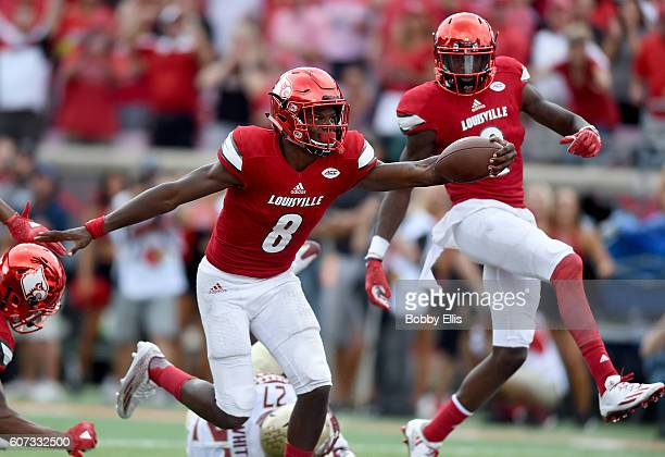 Lamar Jackson of the Louisville Cardinals runs for a touchdown during the game against the Florida State Seminoles at Papa John's Cardinal Stadium on...