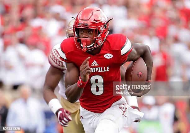 Lamar Jackson of the Louisville Cardinals runs for a touchdown against the Florida State Seminoles at Papa John's Cardinal Stadium on September 17...