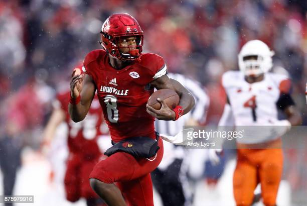 Lamar Jackson of the Louisville Cardinals runs for a touchdown against the Syracuse Orange during the game at Papa John's Cardinal Stadium on...