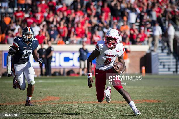 Lamar Jackson of the Louisville Cardinals runs the ball during Louisville's game against the Virginia Cavaliers at Scott Stadium on October 29 2016...