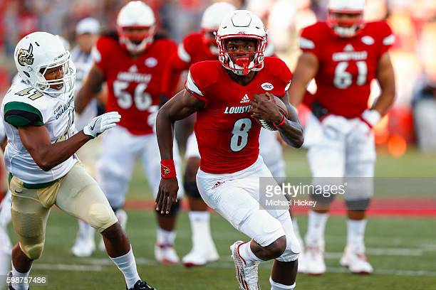 Lamar Jackson of the Louisville Cardinals runs the ball during the game against the Charlotte 49ers at Papa John's Cardinal Stadium on September 1...