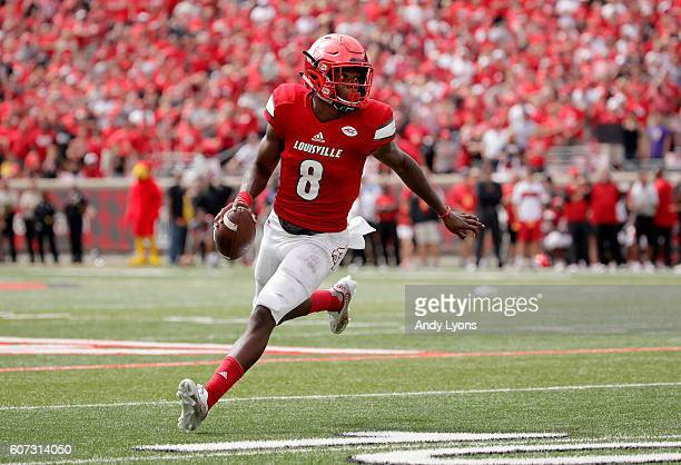Lamar Jackson of the Louisville Cardinals runs with the ball against the Florida State Seminoles at Papa John's Cardinal Stadium on September 17 2016...