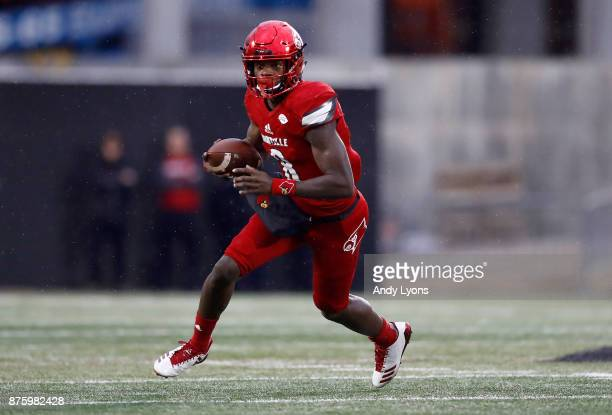 Lamar Jackson of the Louisville Cardinals runs with the ball against the Syracuse Orange during the game at Papa John's Cardinal Stadium on November...
