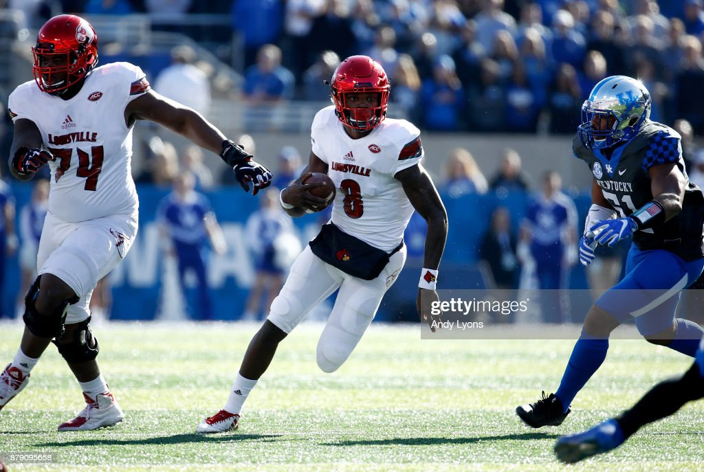 Lamar Jackson #8 of the Louisville Cardinals runs with the ball against the Kentucky Wildcats during the game at Commonwealth Stadium on November 25, 2017 in Lexington, Kentucky.