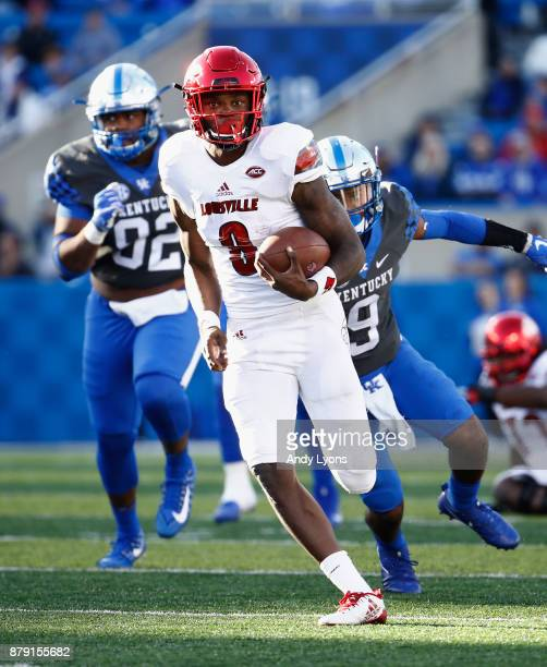 Lamar Jackson of the Louisville Cardinals runs with the ball against the Kentucky Wildcats during the game at Commonwealth Stadium on November 25...