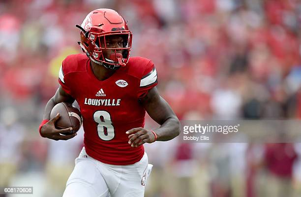 Lamar Jackson of the Louisville Cardinals runs with the ball during the game against the Florida State Seminoles at Papa John's Cardinal Stadium on...