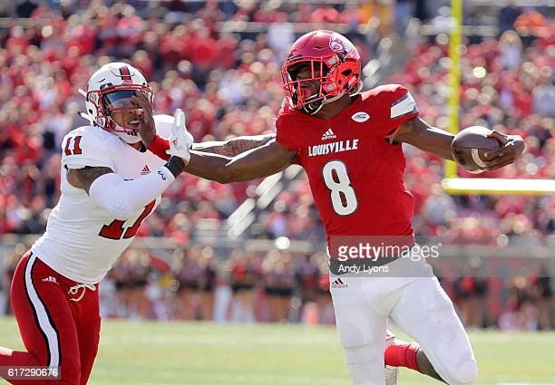 Lamar Jackson of the Louisville Cardinals runs with the ball during the game against the North Carolina State Wolfpack at Papa John's Cardinal...