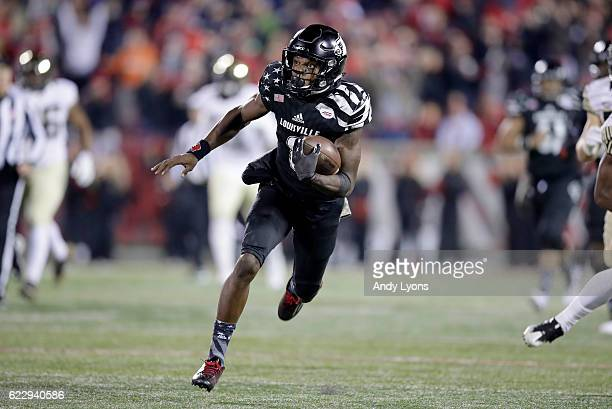 Lamar Jackson of the Louisville Cardinals runs with the ball during the game against the Wake Forest Deamon Deacons at Papa John's Cardinal Stadium...