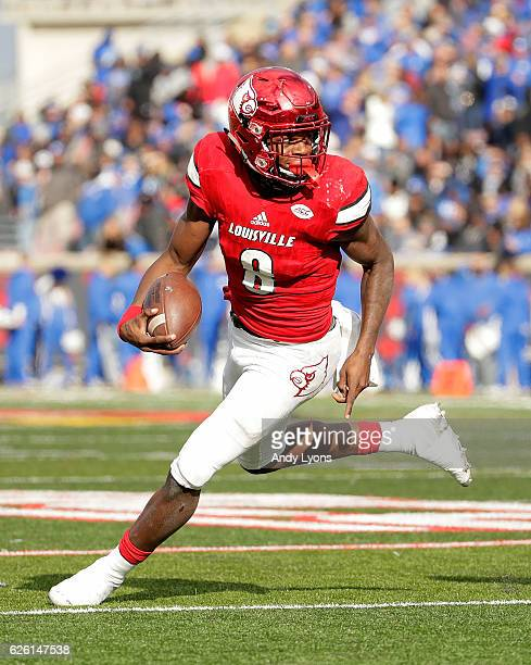 Lamar Jackson of the Louisville Cardinals runs with the ball during the game against the Kentucky Wildcats at Papa John's Cardinal Stadium on...
