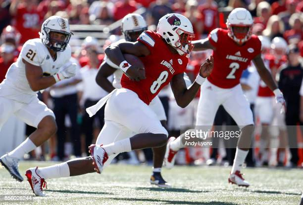 Lamar Jackson of the Louisville Cardinals runs with the ball during the game against the Murray State Racers at Papa John's Cardinal Stadium on...
