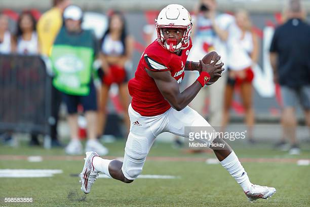Lamar Jackson of the Louisville Cardinals scrambles out of the pocket during the game against the Charlotte 49ers at Papa John's Cardinal Stadium on...