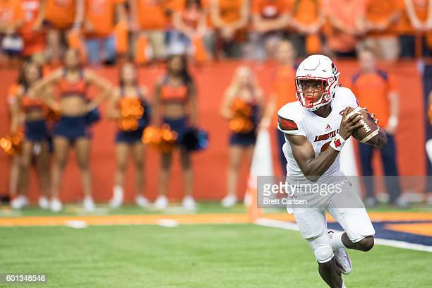 Lamar Jackson of the Louisville Cardinals scrambles with the ball during the first half against the Syracuse Orange on September 9 2016 at The...
