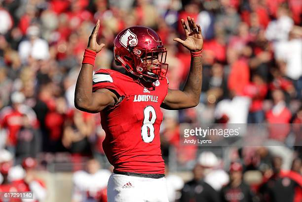 Lamar Jackson of the Louisville Cardinals signals a touchdown during the game against the North Carolina State Wolfpack at Papa John's Cardinal...