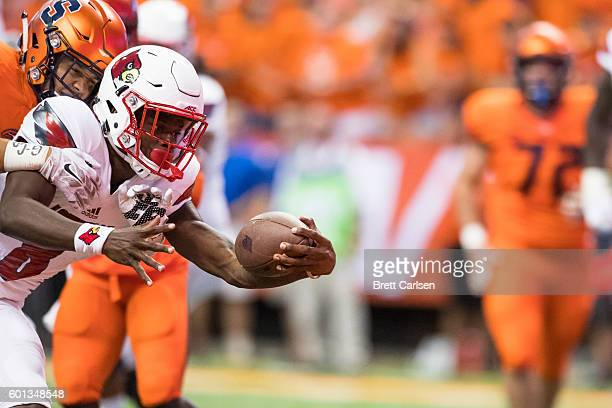 Lamar Jackson of the Louisville Cardinals stretches for a touchdown during the first quarter against the Syracuse Orange on September 9 2016 at The...
