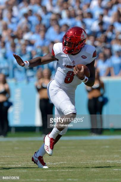 Lamar Jackson of the Louisville Cardinals strikes the Heisman pose as he runs against the North Carolina Tar Heels during the game at Kenan Stadium...