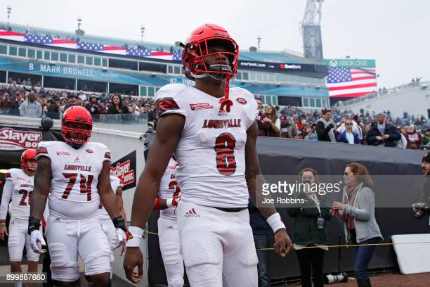 Lamar Jackson of the Louisville Cardinals takes the field prior to the TaxSlayer Bowl against the Mississippi State Bulldogs at EverBank Field on...