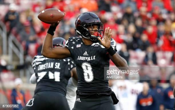 Lamar Jackson of the Louisville Cardinals throws a pass against the Virginia Cavaliers at Papa John's Cardinal Stadium on November 11 2017 in...