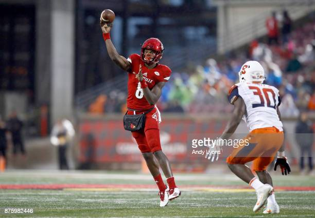 Lamar Jackson of the Louisville Cardinals throws a pass against the Syracuse Orange during the game at Papa John's Cardinal Stadium on November 18...