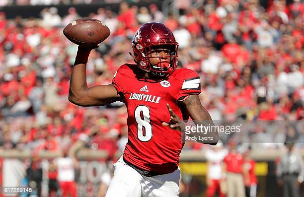 Lamar Jackson of the Louisville Cardinals throws a pass during the game against the North Carolina State Wolfpack at Papa John's Cardinal Stadium on...