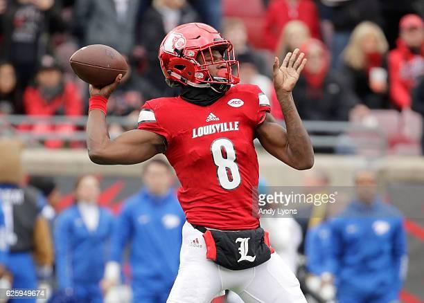 Lamar Jackson of the Louisville Cardinals throws a pass during the game against the Kentucky Wildcats at Papa John's Cardinal Stadium on November 26...
