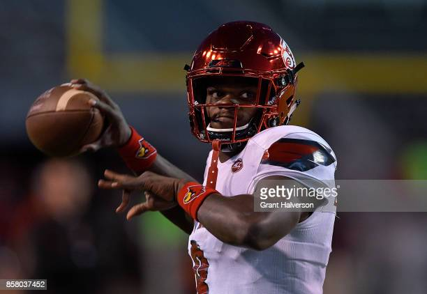 Lamar Jackson of the Louisville Cardinals warms up during the game against the North Carolina State Wolfpack at Carter Finley Stadium on October 5...